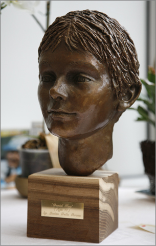 bronze sculpture of boy's head