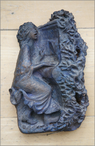sculpture of a woman playing the piano