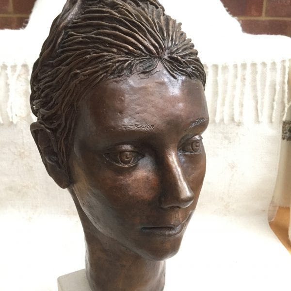 portrait in bronze of young woman
